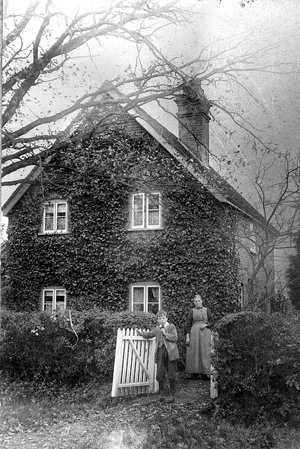 Ernest Kimber with his grandmother, Jame Kimber, outside Cottage Farm, New Road, Pamber Green