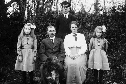 Ernest Kimber standing with (left to right) Doris Kimber, Arthur Kimber, Rose Kimber (née West) and Elsie Kimber