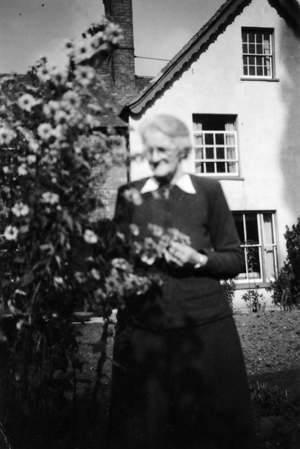 Jessie Rose, born 1878, outside Ravenscot Farm, Pambaer End.
